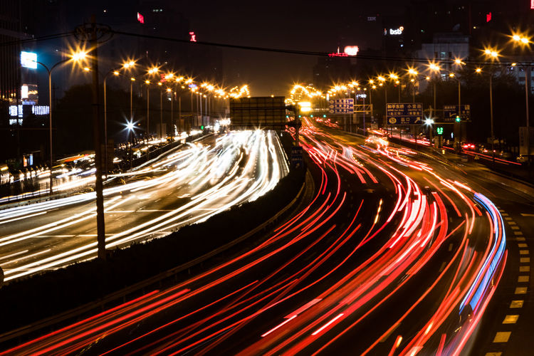 Blurred Motion Busy City City Life Electric Light High Angle View Illuminated Light Trail Lighting Equipment Long Exposure Motion Night Outdoors Red Road Rush Hour Speed Street Street Light Tail Light The Way Forward Traffic Transportation Vehicle Light