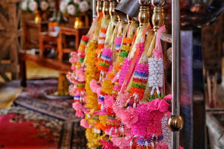 Colorful flower garlands hanging for sale