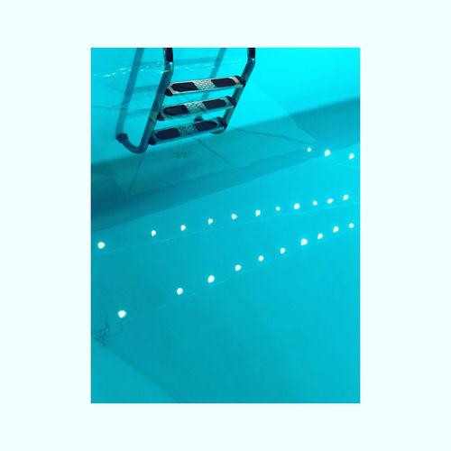 High angle view of illuminated lighting equipment in swimming pool