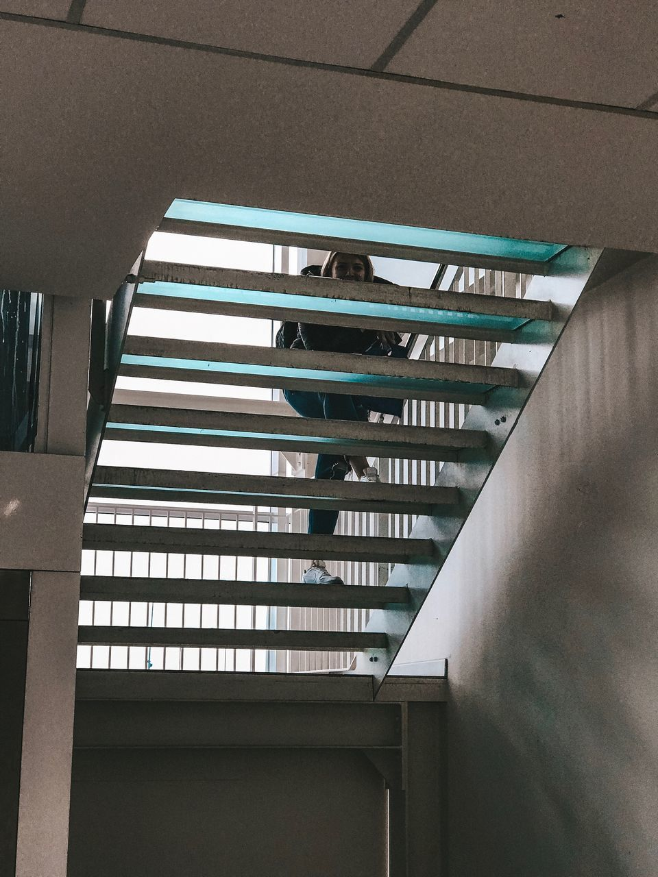 architecture, built structure, indoors, railing, low angle view, no people, building, day, staircase, steps and staircases, pattern, ceiling, glass - material, wall - building feature, window, empty, modern