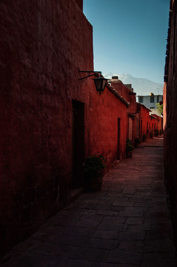 Architecture Building Exterior Built Structure Cobblestone Corridor Day Golden Hour Light No People Outdoors Perspective Peru Red South America