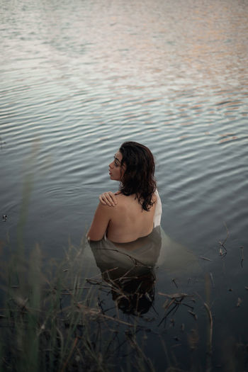 High angle view of woman standing in water