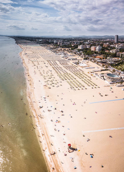 High angle view of crowd on beach against sky