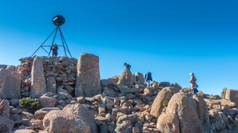Hiking to the summit of Kunanyi / Mount Wellington Hiking Architecture Blue Built Structure Clear Sky Day History Hobart Tasmania Holiday In Tasmania Low Angle View Mountain Peak Nature No People Old Outdoors Rock Rock - Object Sky Solid Stone - Object Summit View Sunlight Tasmania, Australia Tasmanian Landscape Tranquil Scene
