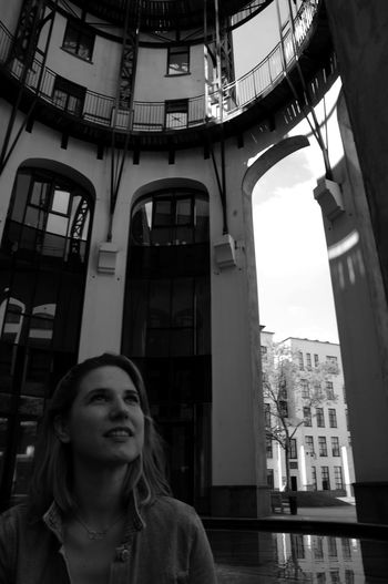 Architecture Built Structure Building Exterior Real People One Person Lifestyles Portrait Young Women Low Angle View Front View Leisure Activity Window Building Young Adult Women Looking Looking At Camera Day Contemplation Beautiful Woman Hairstyle The Portraitist - 2019 EyeEm Awards