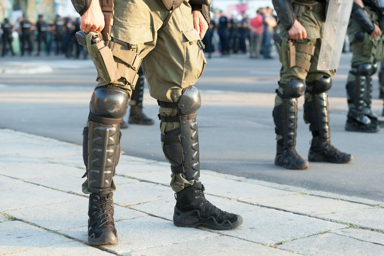 Low section of army soldiers standing on street