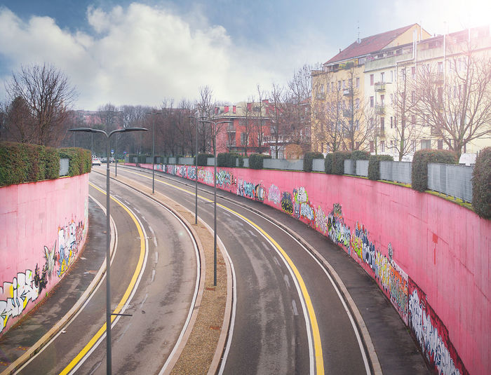 City Cityscape Curve Day Graffiti Wall Happy City Highway Exit Milan No People Outdoors Pink Pink Wall Rail Transportation Road Sky Street Street Lane Street Lanes Street Lights Town Transportation Tree Villapizzone Wall