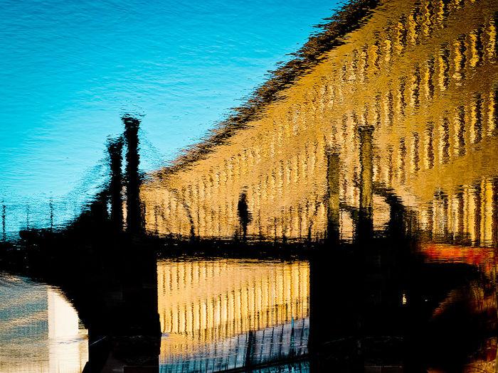 Architecture Bridge Built Structure Day Flip Outdoors Shadow Sunlight Urban Landscape Water