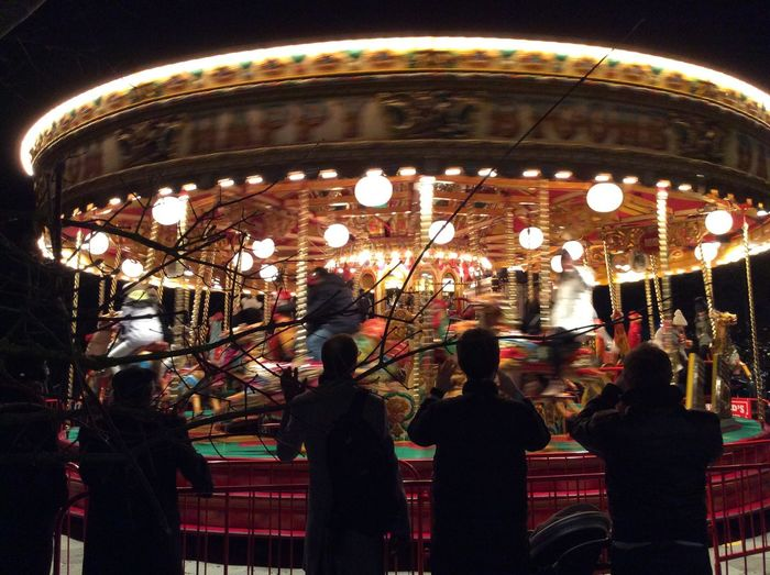 London Adult Amusement Park Amusement Park Ride Arts Culture And Entertainment Blurred Motion Carousel Crowd Enjoyment Group Group Of People Illuminated Leisure Activity Lifestyles Medium Group Of People Men Merry-go-round Motion Night People Real People Women