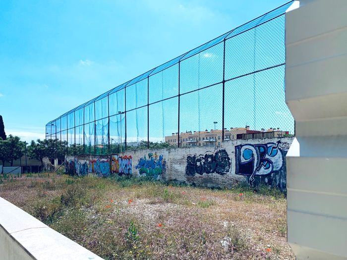 Graffiti on wall in city against sky
