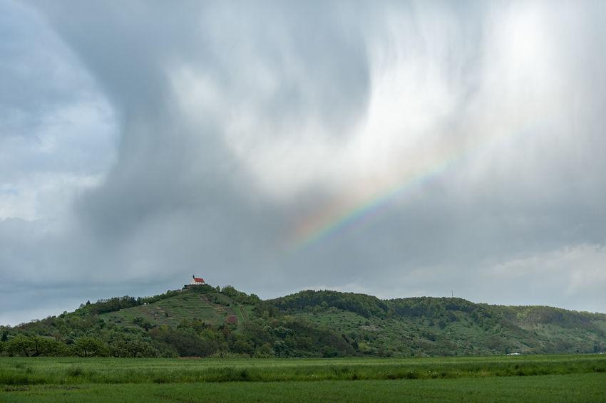 Church Wurmlinger Kapelle Beauty In Nature Cloud - Sky Day Environment Green Color Idyllic Land Landscape Mountain Mountain Peak Nature No People Non-urban Scene Outdoors Rain Rainbow Scenics - Nature Sky Storm Tranquil Scene Tranquility