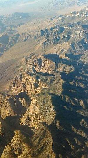 Another great shot of the mountains at sunrise On The Way On Vacation!  Outdoors Outdoor Photography Out My Window Vacation Mountains Mountain Range Beauty In Nature Nature Nature_collection Nature Photography Aerial Photography Aerial View Aerial Shot Sunrise Shadows A Birds Eye View...