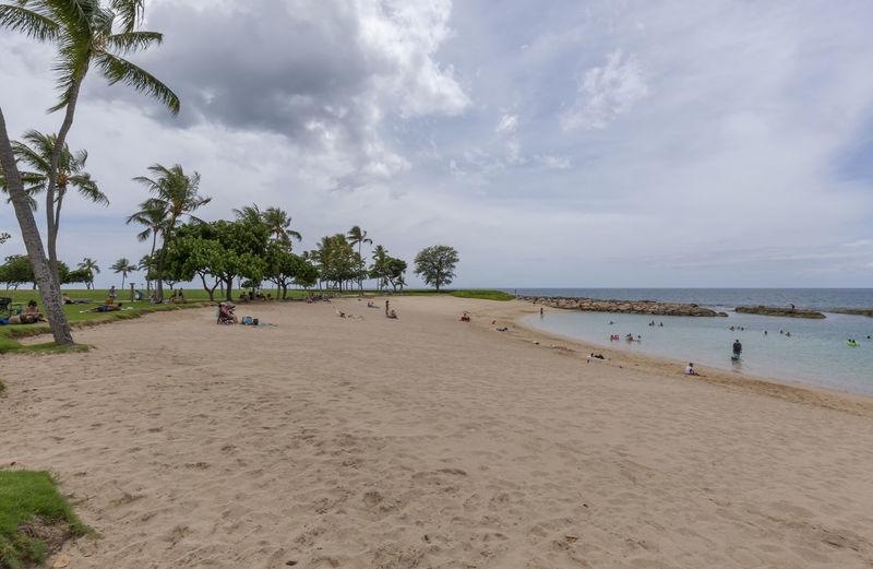 Ko Olina Lagoons Beach Park Beach Park Oahu Hawaii Tropical Paradise Vacations Beach Beachlife Beauty In Nature Cloud - Sky Horizon Over Water Incidental People Ko Olina Lagoon Nature Outdoors Palm Tree Resort Sand Scenics - Nature Sea Sky Tranquil Scene Tranquility Tree Tropical Climate Water