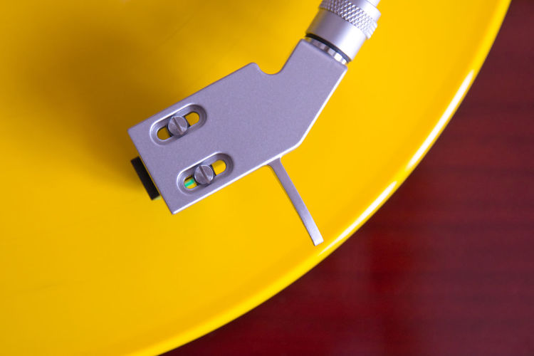 Close-up of yellow telephone on table