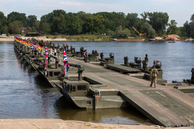 Floating Bridge Soldiers Day Large Group Of People Men Military Military Equipment Nature Nautical Vessel Outdoors People Real People River Sky Transportation Tree Water