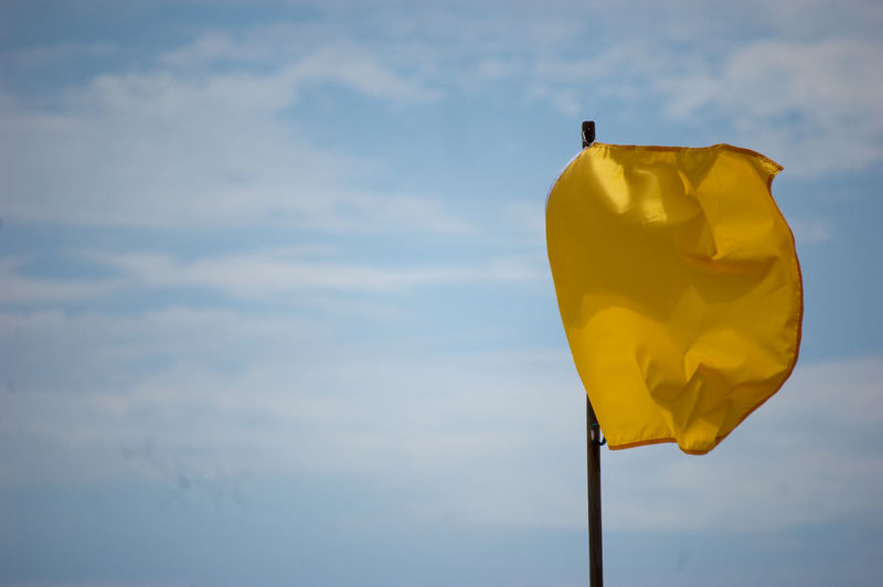 Close-up Cloud - Sky Day Flag Low Angle View No People Outdoors Sky Yellow