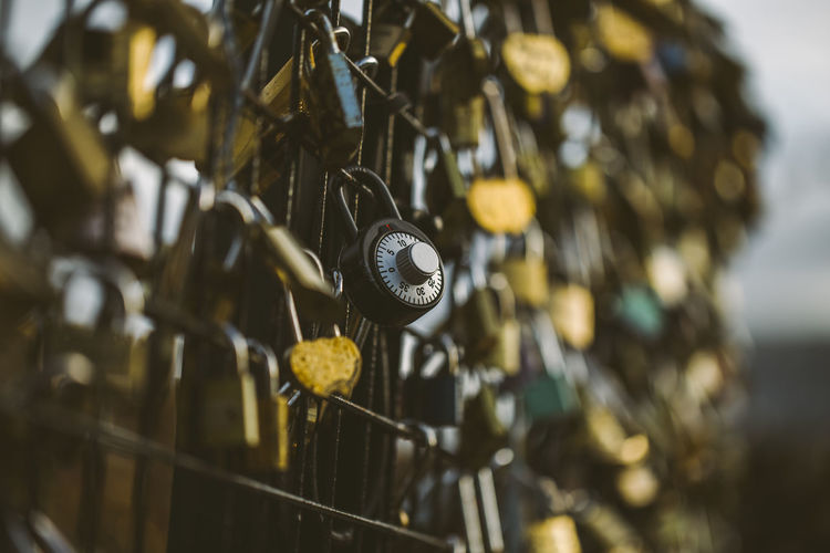 Close-Up Of Padlocks Hanging On Metallic Railing