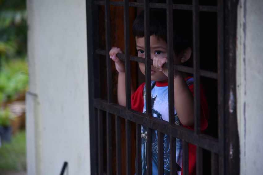 Child Children Only Punishment Cage Childhood Indoors  My Son Love Grounded Innocence Of Youth Innocent Face Miss Someone Boy Cute Cute Boy Growth Handsome EyeEmNewHere