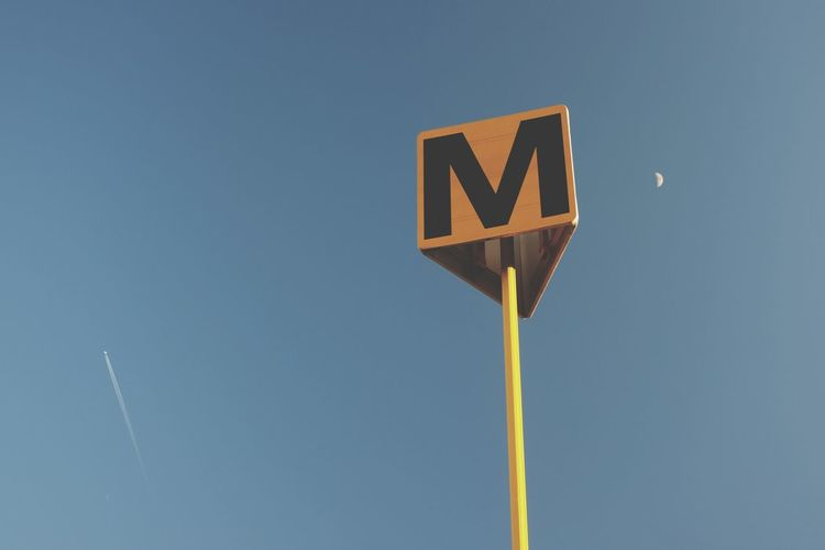 Moon Communication Sign Text Western Script No People Blue Road Sky Low Angle View Road Sign Nature Capital Letter Direction Guidance Clear Sky Copy Space Outdoors Day Information Symbol