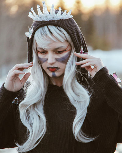 Close-up of young woman with halloween make-up and costume