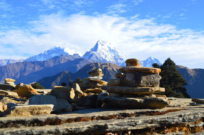 Stones at annapurna conservation area against snowcapped mountain