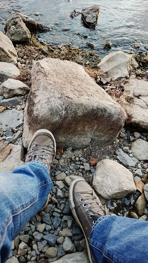 Waiting for sunset... Stay tuned! Canada Coast To Coast Beach Shore High Angle View Day Outdoors Shoe Low Section Nature Human Leg Water Pebble Real People Sea Blue Pebble Beach Beauty In Nature One Person Close-up Human Body Part Samsungphotography Samsung Galaxy S7 Shoes Converse Relaxing