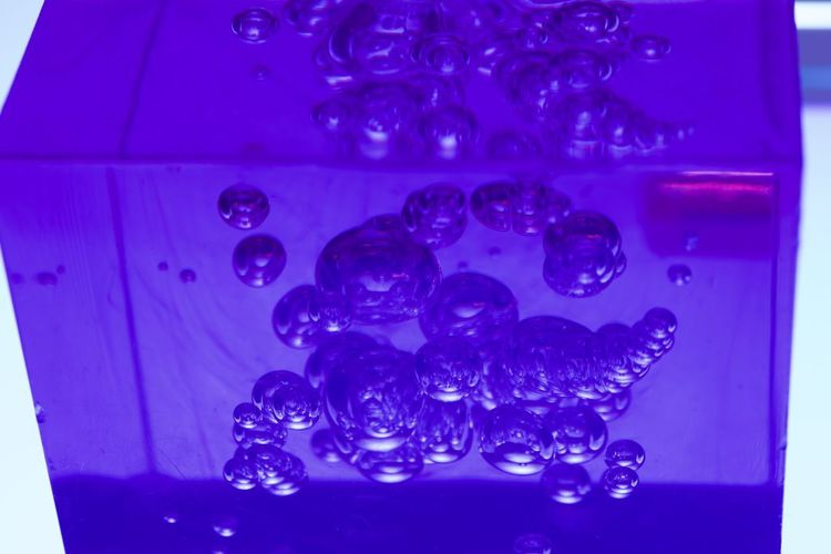 Close-up of bubbles against blue background