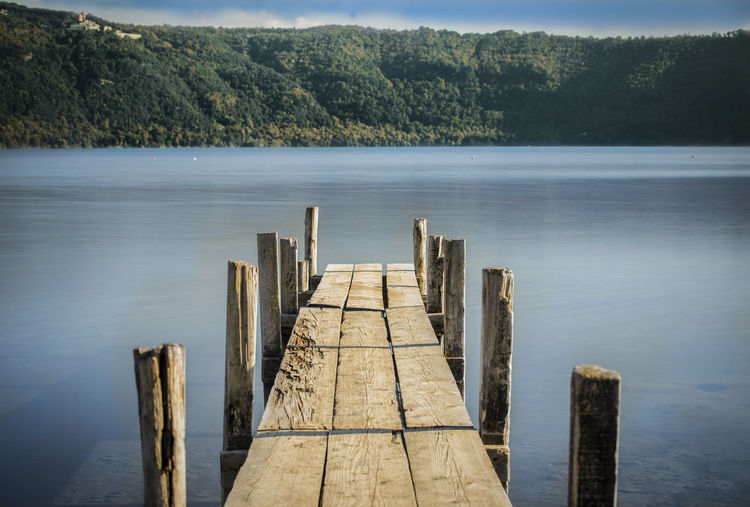 Wooden posts on pier over lake