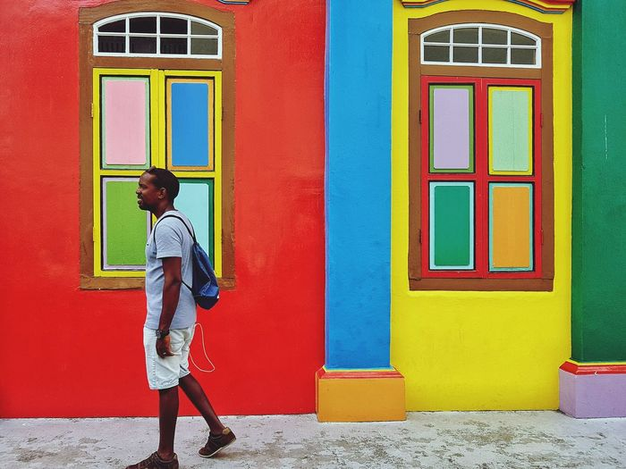 Colours Colourful Building Colour Contrast Bright Colours One Man Man Walking In Town Colourful House Black Male Black Man Walking Man Strolling In Town in Singapore