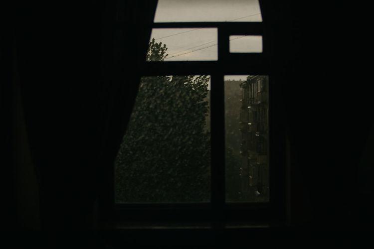 Close-up of window in dark room