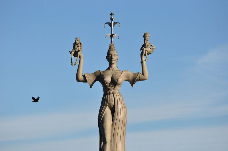Statue of imperia against blue sky