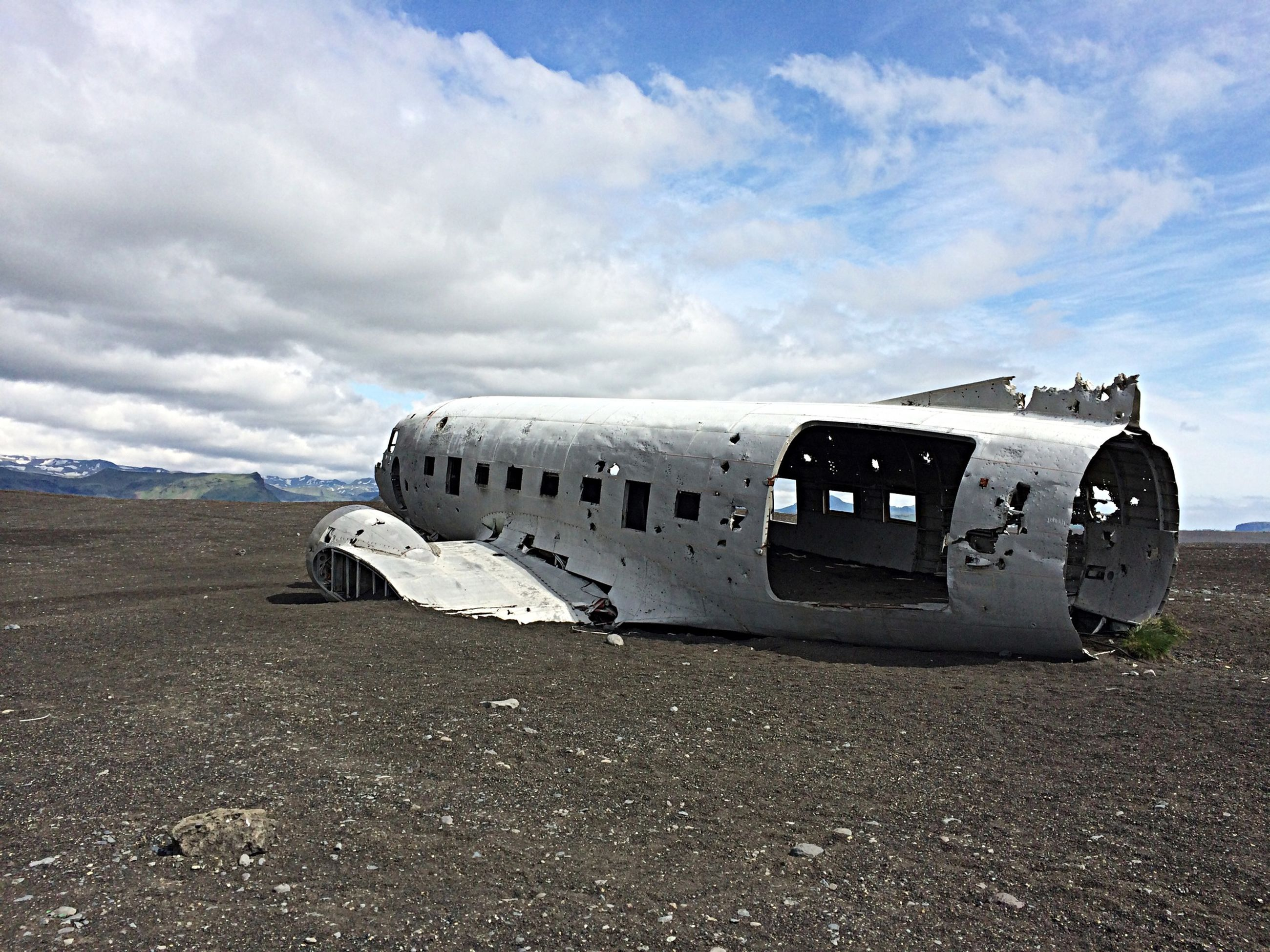 transportation, sky, cloud - sky, mode of transport, abandoned, land vehicle, obsolete, damaged, car, cloud, run-down, landscape, cloudy, day, deterioration, travel, old, built structure, no people, outdoors