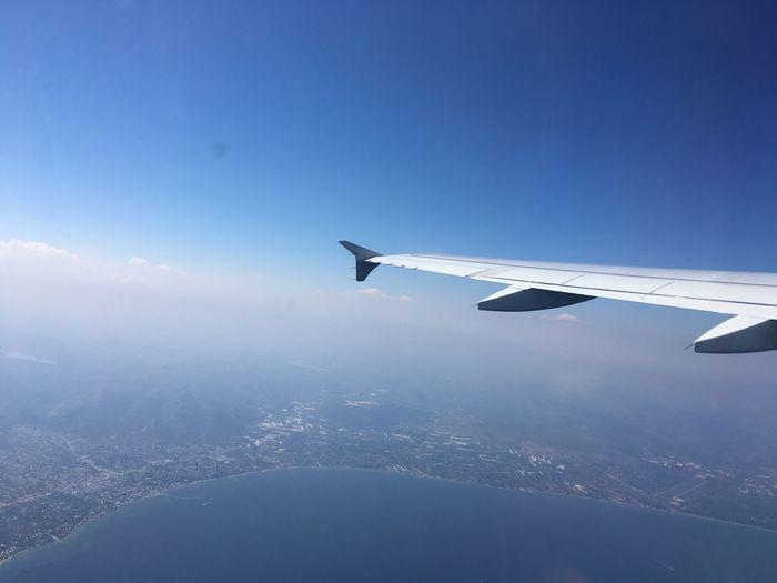 Aerial View Air Vehicle Aircraft Wing Airplane Airplane Wing Beauty In Nature Blue Day Flying Journey Mid-air Nature No People Outdoors Scenics Sky Tranquil Scene Tranquility Transportation Travel