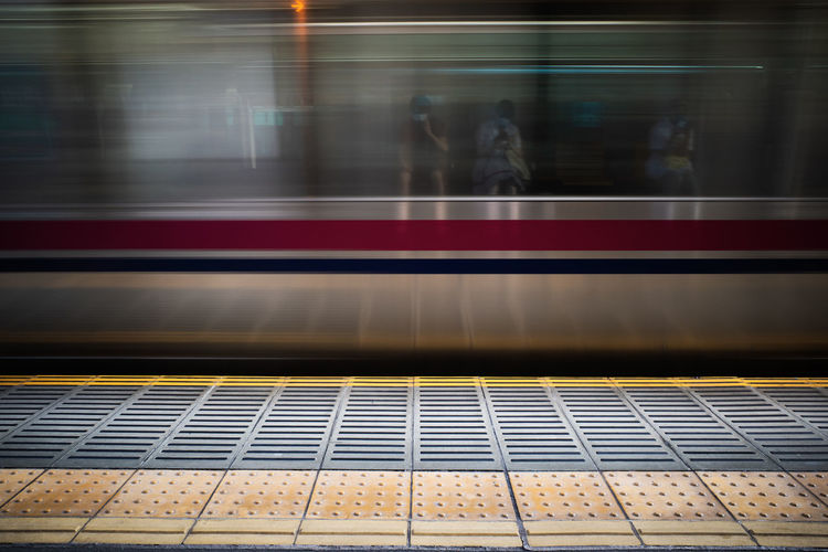 Blurred motion of train at railroad station