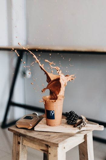 Close-up of coffee splashing on table