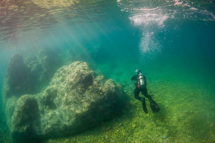 High angle view of scuba diver in sea