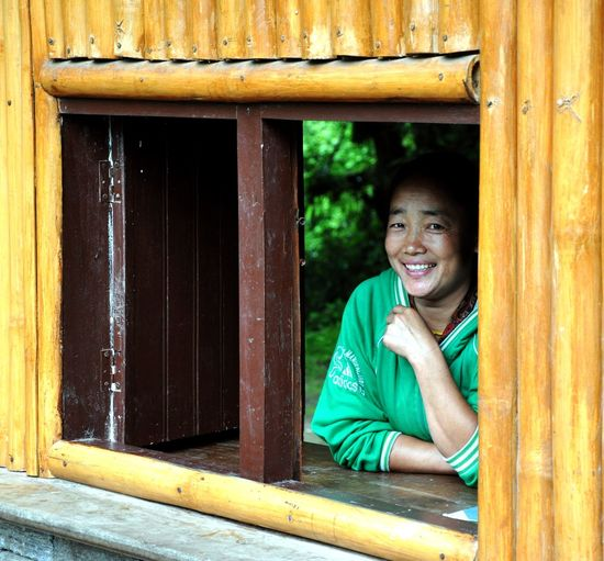 Yaksum, Sikkim Portrait Wood - Material One Person Smiling Happiness Looking At Camera Traditional Clothing Real People Photography Themes One Woman Only Emotion Toothy Smile Window Leisure Activity Tourist Destination Moments Of Happiness International Women's Day 2019