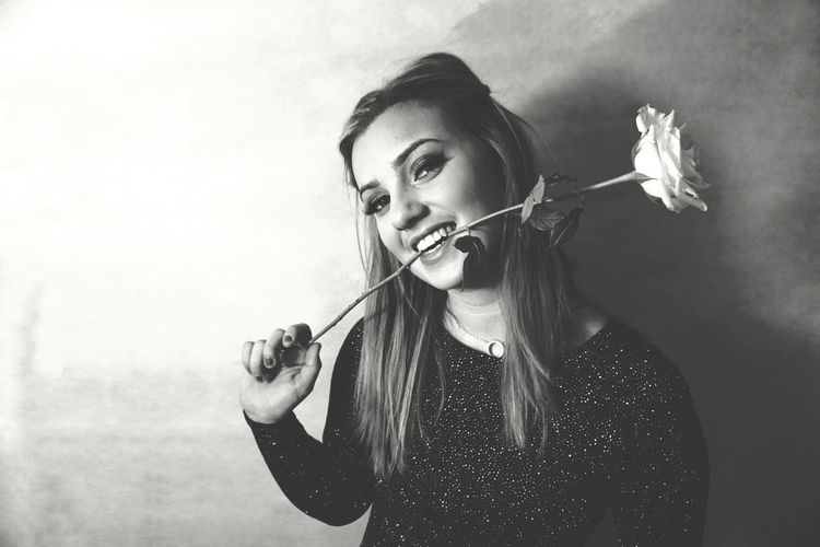 Portrait Of Holding Flower In Mouth