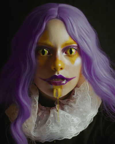 Portrait of woman with purple face against black background