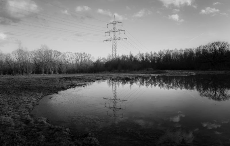 Sky Water Electricity Pylon Electricity  Reflection Technology Lake Tranquility Cable Nature Tree Tranquil Scene Cloud - Sky Plant Power Supply Power Line  Beauty In Nature No People Outdoors Black And White Electricity  Power Line