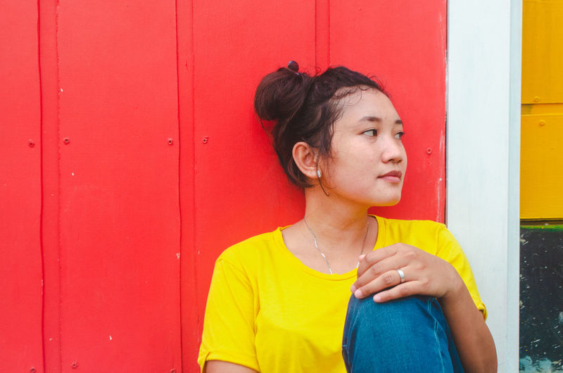 Street Photography Streetphotography Young The Portraitist - 2019 EyeEm Awards Happy Happy People Smiling Portrait People Woman Streetphotography Young Women The Street Photographer - 2019 EyeEm Awards Portrait Model Colour Colors Colorful Colors Red Yellow Teen Wall Woman Asian  ASIA Waiting Alone Lonely Fresh
