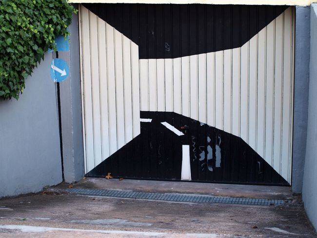 Sometimes art can be so simple... Architecture Building Exterior Built Structure Corrugated Iron Creativity Garage Door Megalomaniac No People Outdoors Painting Street Art/Graffiti Too Big For One's Boots