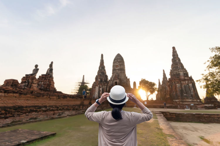 Rear view of man in temple against sky