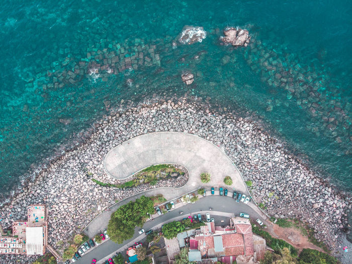 Santa Maria la Scala, old fishing village High Angle View Sea Water Architecture Aerial View Nature City Day Outdoors Built Structure Building Exterior People Beach Plant Travel Destinations Land Drop Airplane Sicily Catania Acid Santa Maria La Scala