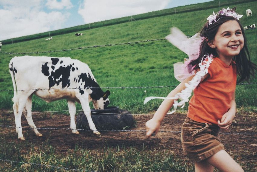 a girl and a cow. Storrs, CT. 2014. The Moment - 2014 EyeEm Awards Capture The Moment Connected With Nature Children Motion