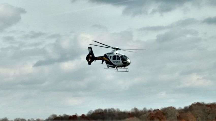Medivac chopper on its way to Monongahela Valley Hospital. Helicopter Transportation Mode Of Transport Danger Air Vehicle Firefighter Flying Outdoors Rescue Service Day Adult People Sky Full Frame No People Tree High Angle View Cloud - Sky