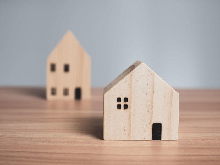 Close-up of toy on table against building