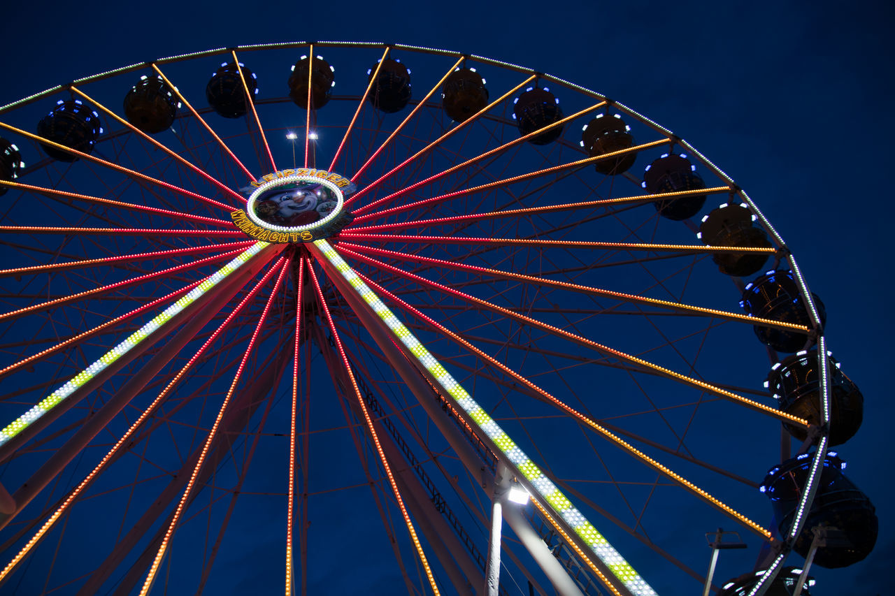amusement park, arts culture and entertainment, amusement park ride, ferris wheel, circle, big wheel, low angle view, no people, night, leisure activity, clear sky, outdoors, illuminated, sky, carousel