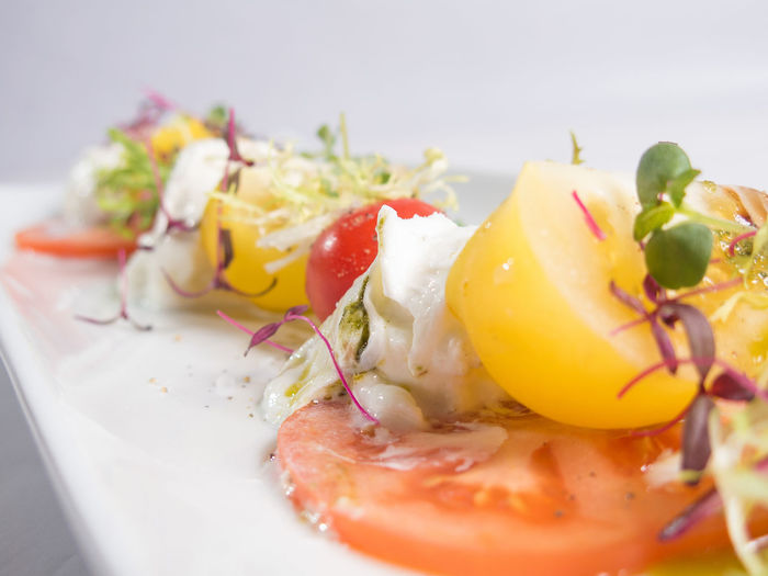 Close-up of poached egg and tomatoes served in plate