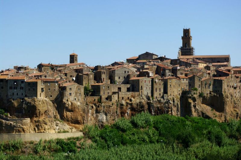 Old house at pitigliano against sky
